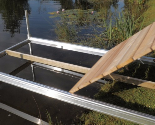 Small wooden boats designs build my own boat dock build for Fish house frames manufacturers